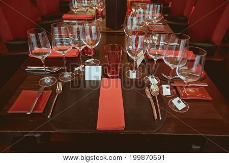 Wine Glass Setup On The Dinner Table In Luxury Dinner Party, Blurry Background With Vintage Color St