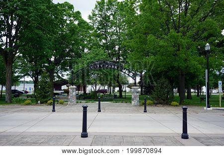 CADILLAC, MICHIGAN / UNITED STATES - MAY 31, 2017:  People may enjoy the Cadillac Commons City Park, between downtown Cadillac and Lake Cadillac.