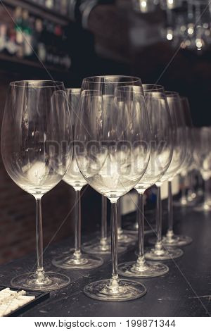 Wine Glass On Black Table Setup For Party In The Bar With Vintage Color Style, Blurred Background.