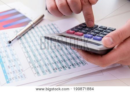 Finance analyst looking and financial reports