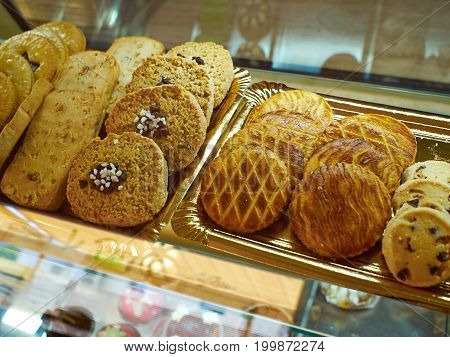 Group of assorted fresh delicious cookies for sale in a bakery shop