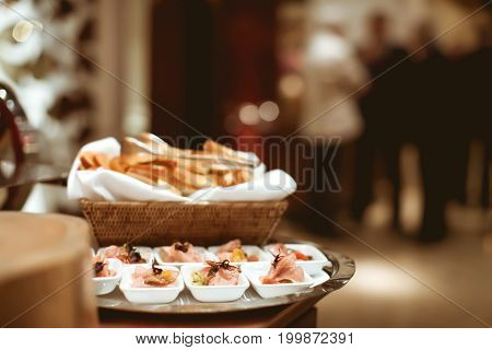 Sliced Beef Decoration On The White Plate In Luxury Dinner Party, Blurry Background With Vintage Col