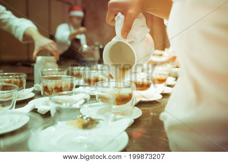 Blurry Background Vintage Color Style Of Chef Pour Soup Into Bowl Glass On The Table For Luxury Dinn