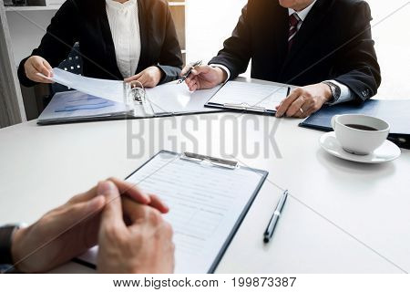 Businessman Conducting An Interview With Businessman In An Office
