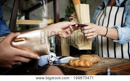 Customer Buying Fresh Baked Bread in Bakery Shop