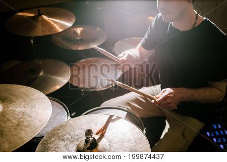 Drummer playing on drum set. Music recording process, band rehearsal