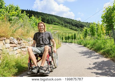 Young man in wheelchair enjoying time outdoors
