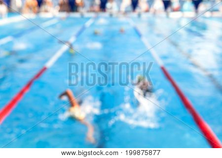Blurry Background Of Student Swimming Race In The Swimming Pool.