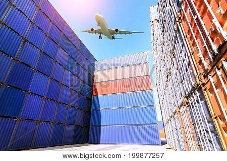Forklift truck lifting cargo container in shipping yard or dock yard against sunrise sky with cargo container stack in background for transportation importexport and logistic industrial concept