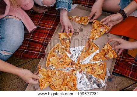 Friends pizza party top view. Communication together outside, unhealthy food