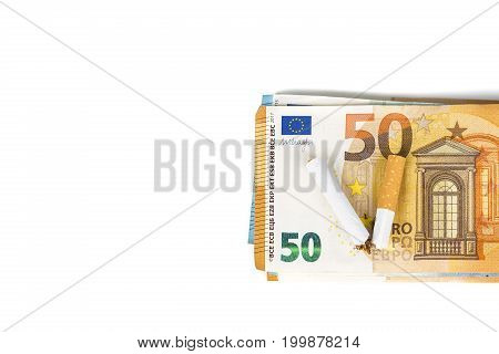 Cigarette broken on euro banknotes. Concept of waste of health and money lost due to smoking addiction - Stopping smoking