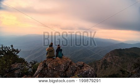 Traveler sightseeing the beautiful scenery of nature and mist during time the sunrise at Doi Luang Chiang DaoChiang Mai province in Thailand is a very popular for photographer and tourists.