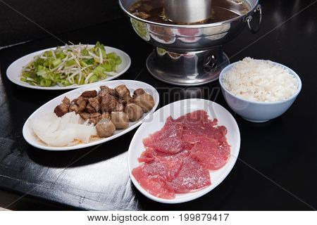 Dipping Beef And Stewed Beef And Rice With Silver Pot On Black Table. Street Food Thai Style
