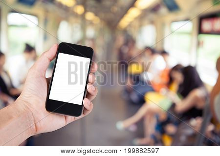 Person Using Smartphone White Screen Holder On Hand With Blurry Background Of Passenger In Skytrain