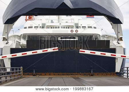 Norwegian car ferry landing at port. Open barrier. Horizontal