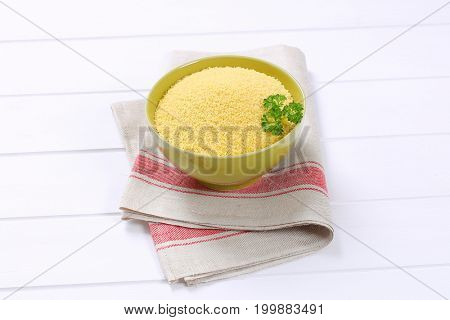 bowl of raw couscous on place mat