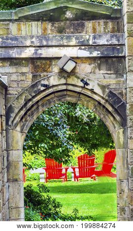 NEW HAVEN, CONNECTICUT-JUNE 24, 2017 Stone Arch Red Chairs Old Campus Yale University New Haven Connecticut.