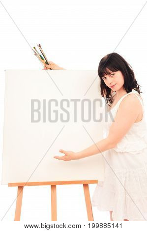 Studio shot of a young woman with blank canvas