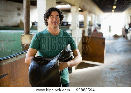 Mature man working in the stable