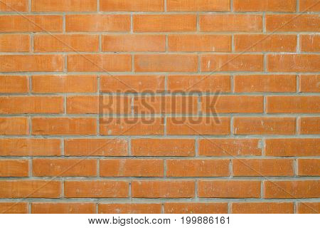 Brickwork from red bricks with spots of solution