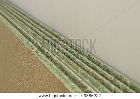 Several moisture-resistant sheet-shaped chipboards against the wall
