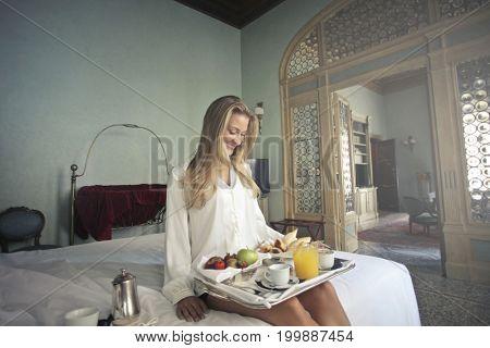 Tasting a fresh breakfast in a luxury hotel suite