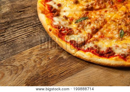 Bolognese Pizza On Wooden Table.