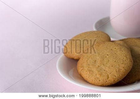 Honey Snaps on Plate with Cup with Pink Background - Horizontal with Copy Space Left