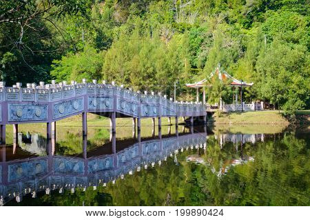 Lake In Tropical Area At Afternoon Reflex Water With Pavilion In Thailand