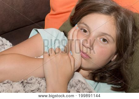a young cute child girl have a toothache