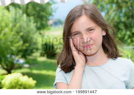 a young girl child an earache outdoor