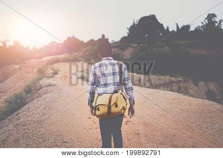 Hipster With Backpack Enjoying Hiking At Mountian With Beautiful Of Sunset, Vintage Tone