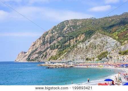 Beautiful daylight view to blue sea and green mountains. Monterosso al Mare, Italy. Cinque Terre
