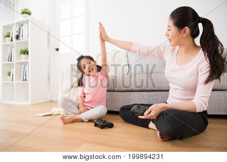 Daughter And Elegant Mother Raised Hands Clapping