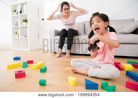 Excited Daughter Playing Video Games By Controller