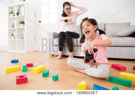 Child Girl Playing Video Games Having Fun