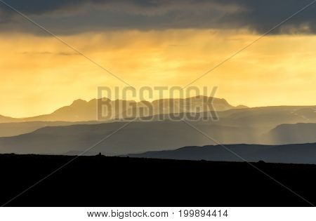 Colorful sunlight sunset with layered mountains. Amazing view of the landscape in Iceland.