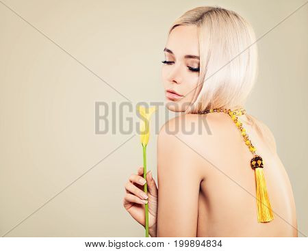 Sexy Blonde Model Woman. Cute Face Yellow Flower Blonde Hair and Jewelry. Female Back