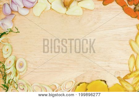 Herbs and spices sliced for cooking Thai food on wooden board and natural food additives healthy food concept copy space for word