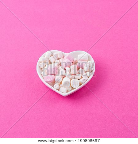 red heart-shaped plate with marshmallows space for text congratulations on Valentine's Day top view