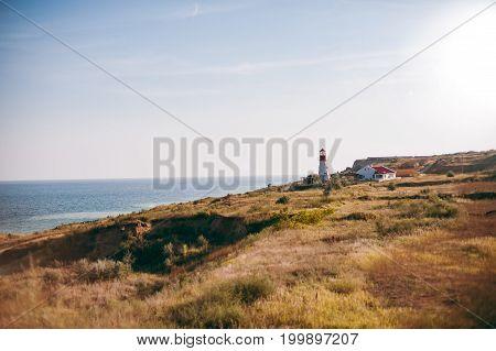 The lighthouse over the sea near the house