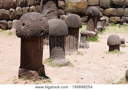 Peru Inca prehistoric ruins in Chucuito near Puno Titicaca lake area. This photo present stone phallus in temple de la Fertilidad