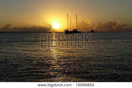 Sailboats In Sunrise Over Water At A Safe Haven.