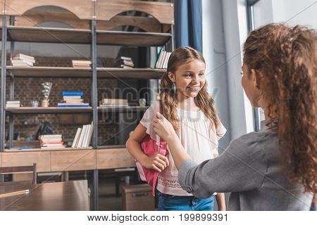 Beautiful Young Mother Preparing Her Little Daughter For School
