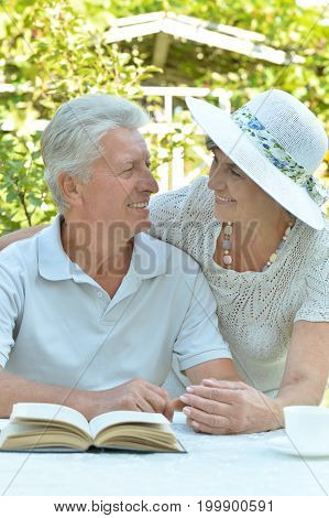 senior couple  reading a book and drink tea