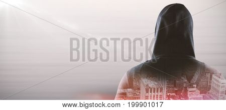 Rear view of spy in hoodie against composite image of abstract backgrounds