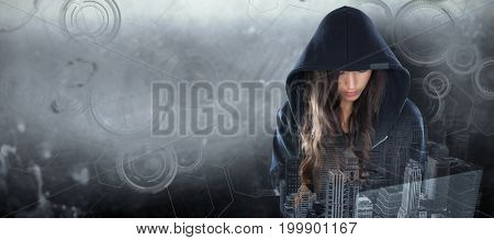 Female hacker in black hoodie using laptop against interface