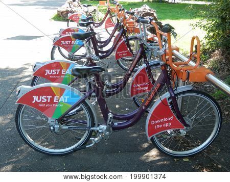 Reading England - August 5 2017: Bicycles for hire on bank of river Thames in Reading Berkshire England