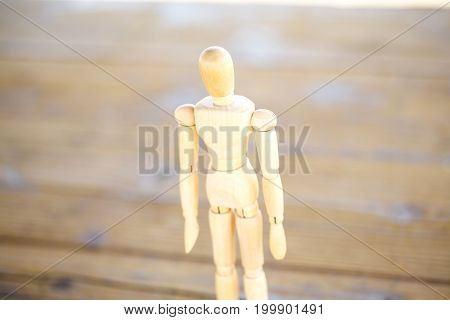 Wooden artist mannequin isolated on wooden table