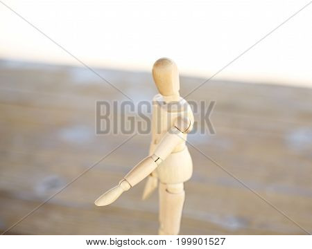 Wooden artist mannequin isolated on the table